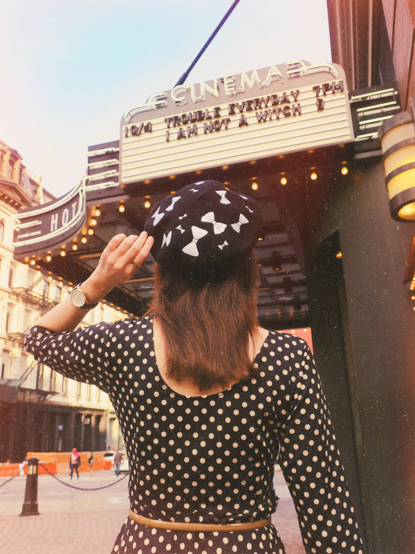 polka dot dress | beret | bows | retro style | movie marquee