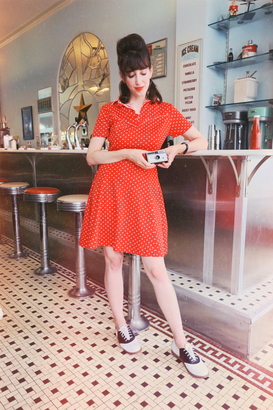 polka dot dress | vintage camera | vintage diner | vintage style | retro style | polka dot dress